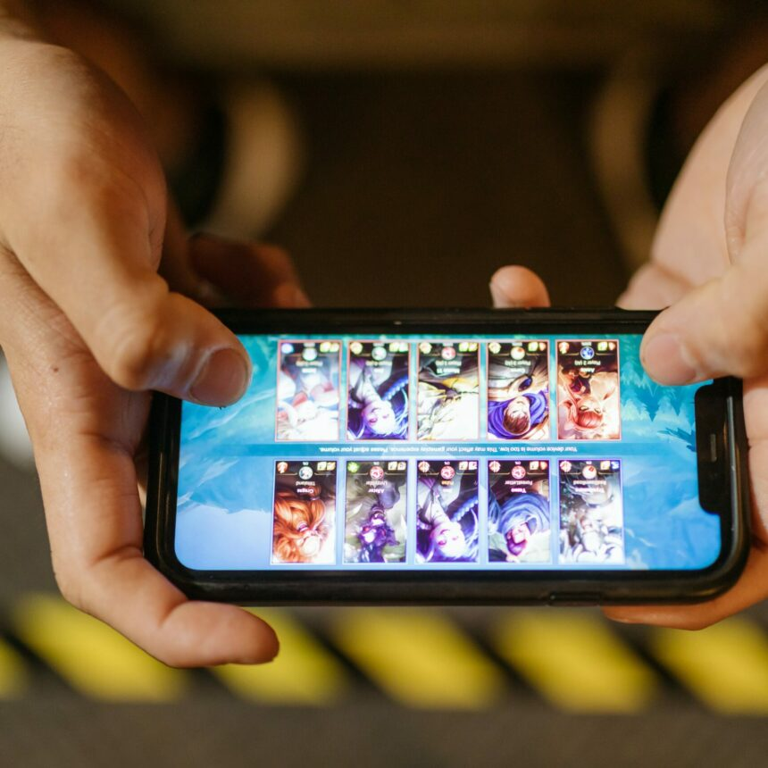 A phone seen from the top held by 2 hands horizontally with a game open